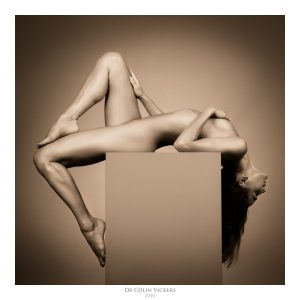 Fine Art Photographer Vienna - Nude Dancer Stretches Around Box